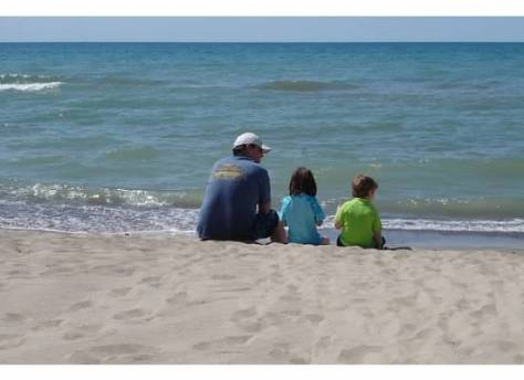 One of my uncles with the next generation at Lake Michigan.
